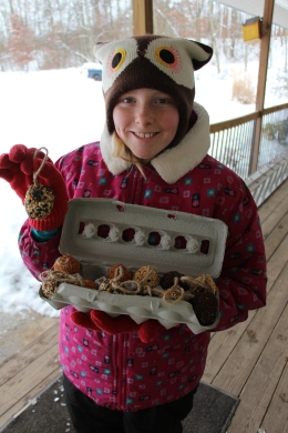Molly with our Christmas gift of birdseed ornamnets.