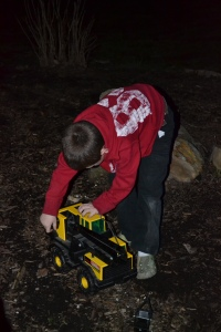 Tyler playing with his Tonka truck in the dark