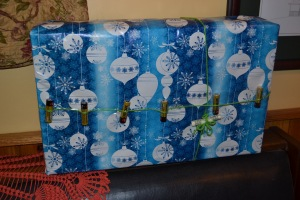 Tyler's wrapped gift. He included 6 batteries which he wrapped on the outside and a dollar of his allowance that he wanted to give his brother. :)