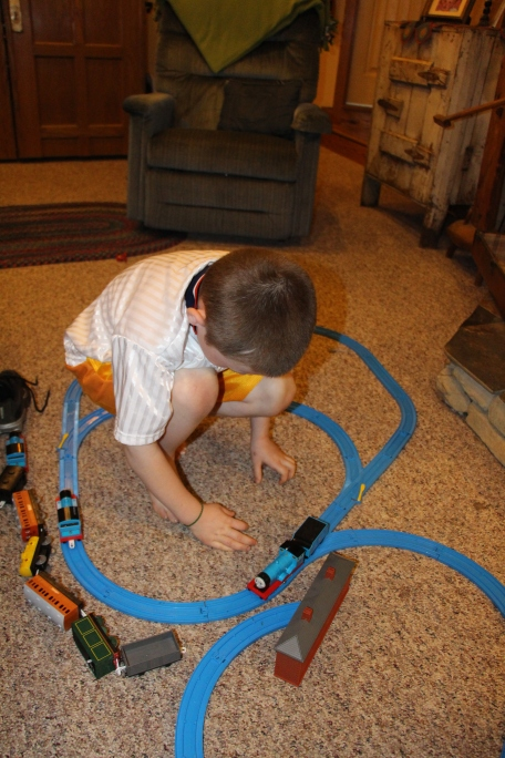 Tyler with his new train set.