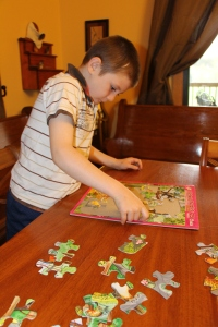 Tyler working on puzzles