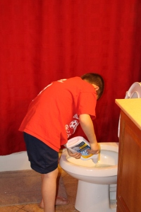 Tyler helping Molly clean toilets.