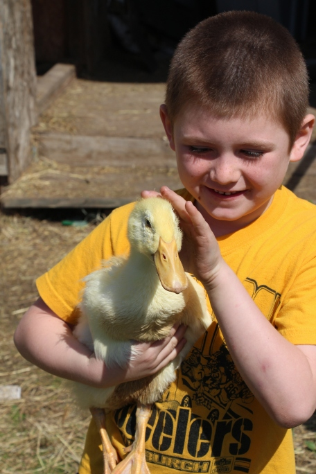 Tyler and his pet duck, Pretty.