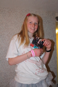 Molly with the CD she bought with her money.