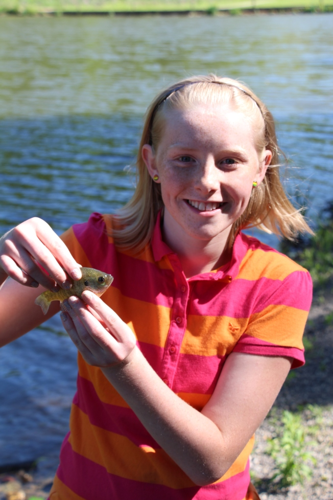 Molly with a baby Blue Gill that she caught..