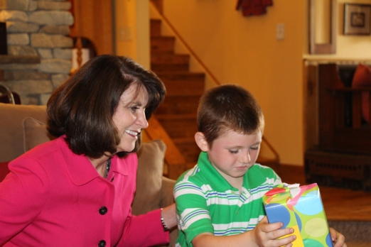 Tyler helping Sister Stevens open her gift.