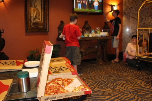 Our pizza party in the lobby. Notice the kids using luggage trolleys as tables. :)