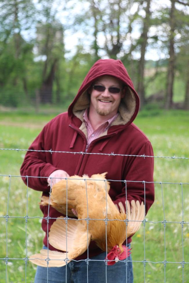 """Toby taming """"mean Eddie"""" the grumpy rooster."""