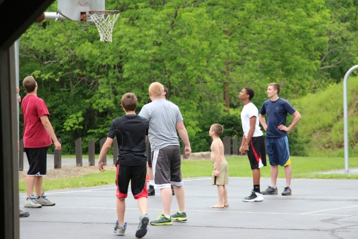 Tyler playing basketball with the big boys.