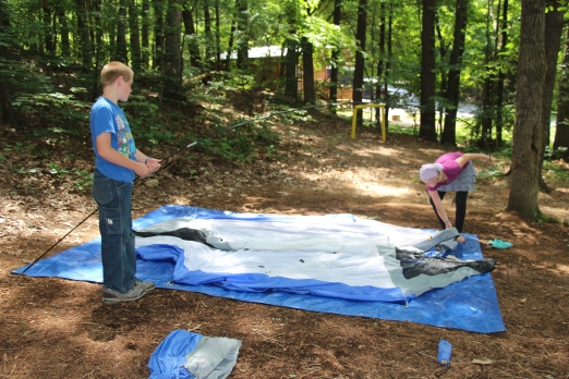 Molly and Rusty setting up the tent.