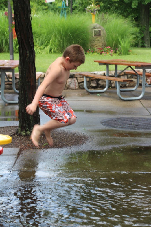 While waiting for the whistle that allowed us back into the pool Tyler took advantage of the sun and the puddles!
