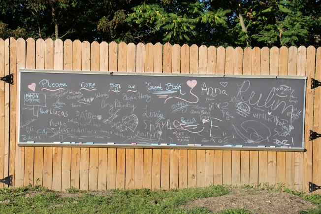 "When people arrived we asked them to sign our ""guest book."" Here are the names of some of the special people who have walked this adoption road with us and joined us to celebrate."