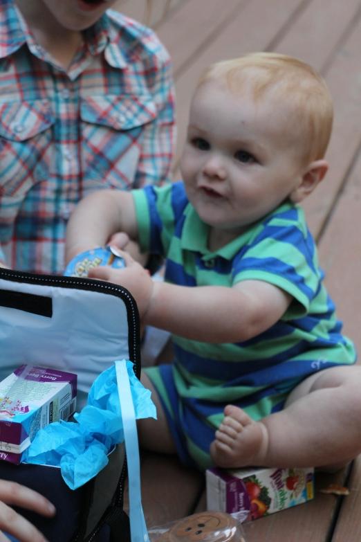 Noah opening his gift.