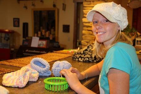 Molly making hats..