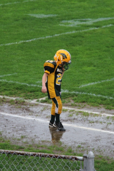 Tyler playing in the puddles before the game began.
