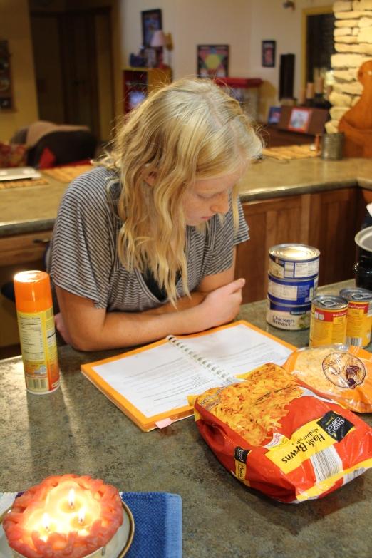 Molly making dinner.