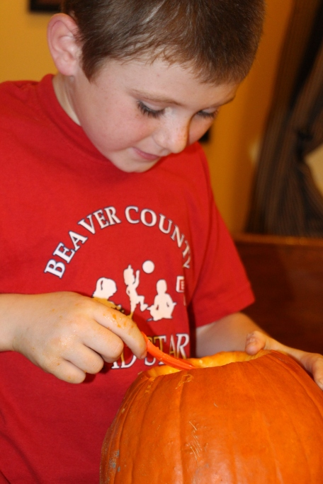 Tyler scooping out pumpkin guts :)