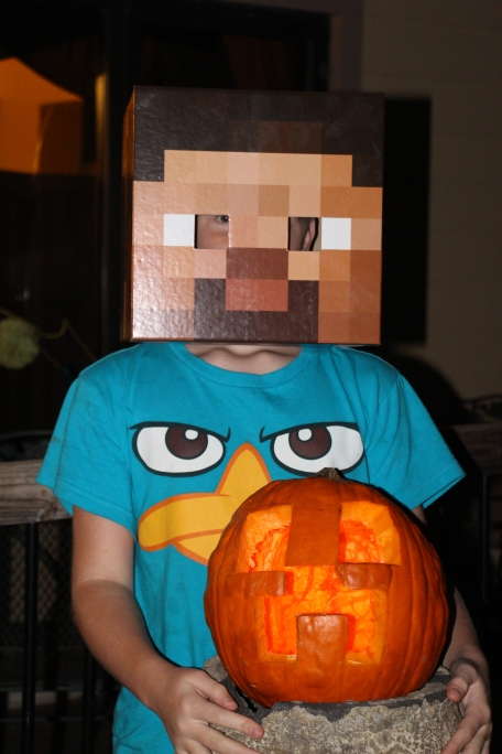 Rusty, dressed as Steve, with his creeper pumpkin.
