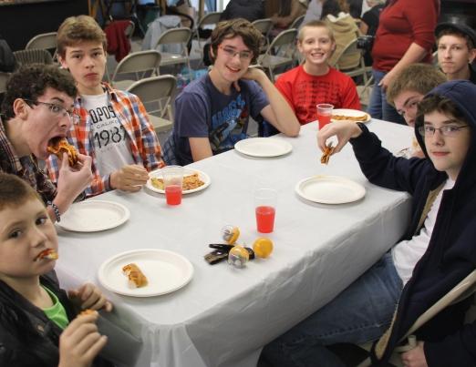 The boys enjoying their pizza :)