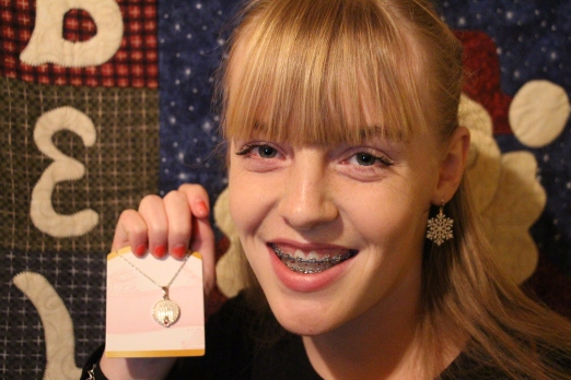 Gracie with her Personal Progress medallion.