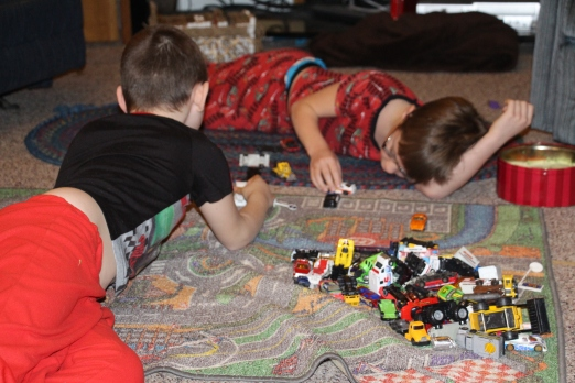 The boys playing cars.