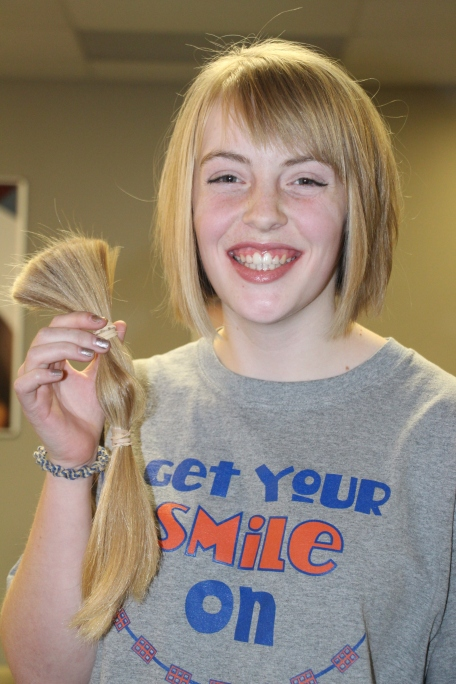 Grace with her hair donation.