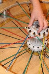 Ozzie building a bike wheel.