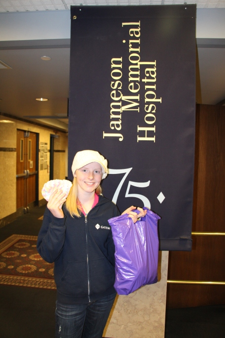Molly and her bag of baby hats to donate.