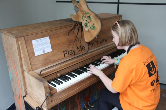 "Gracie's enjoyed practicing her piano pieces at the ""play me"" piano in the lobby."