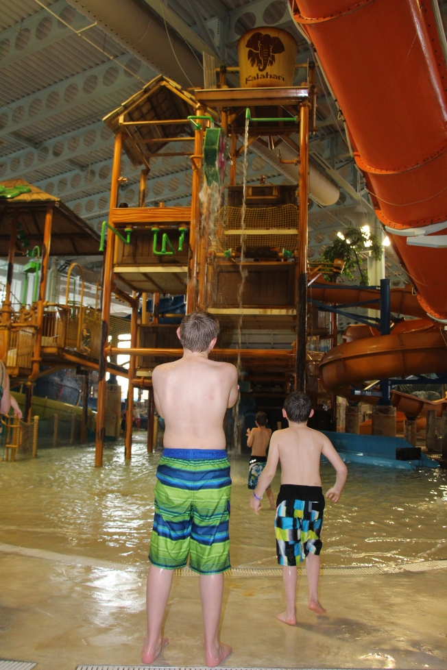 Waiting for the water to fall at the water play area.