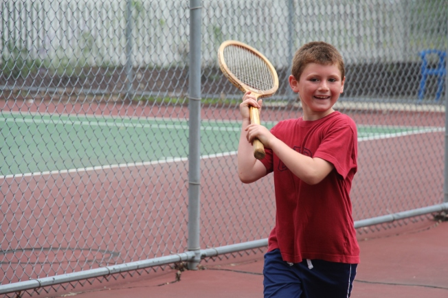 "For Tyler's ""Gotcha Day"" celebration he chose to play tennis as a family and go out for ice cream."