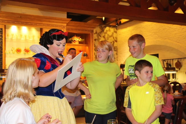 Snow white was darling! Our photo mats are officially filled. We can't wait to frame them with a Disney photo when we get home.