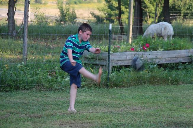 Tyler kicking the football.