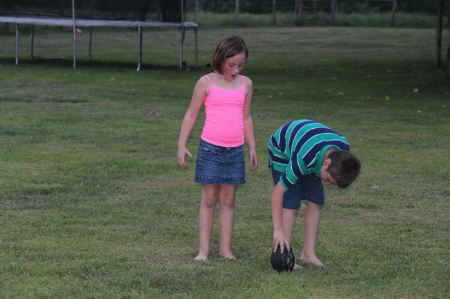 Tyler teaching his little sister how to properly kick a football :)