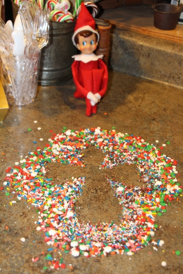 "One night Buster got into the cookie decorating sprinkles and decided to make a ""snow"" angel."