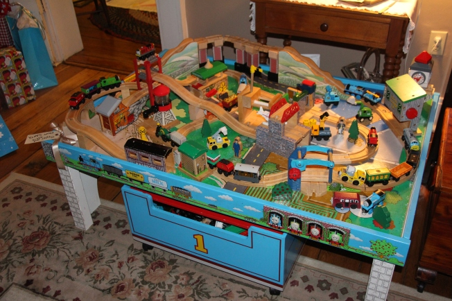 The boys received a joint gift from Santa...a slightly used Thomas the Train set that Santa found for a steal on craigslist. It came with track, trains, buildings, table and storage bin. Santa is hoping this shared gift with encourage the boys to play with each other and promote brotherly bonding.