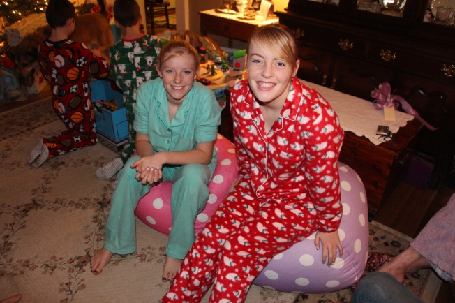 The girls were allowed to open their gift from Mimi and Pop pop before stockings were handed out. Mimi thought they could use them as they opened gifts. The both received beanbags for their rooms. Both were excited to have a comfy reading spot for their rooms.
