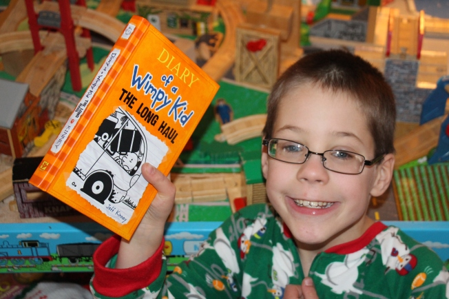 """Ozzie's favorite gift. He has all the other """"Diary of a Wimpy Kid"""" books and was hoping to receive the latest one for his collection."""