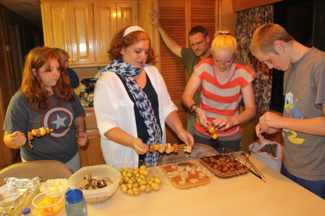 On our final night we had shish kabobs on the grill. The kids making their shish kabobs.