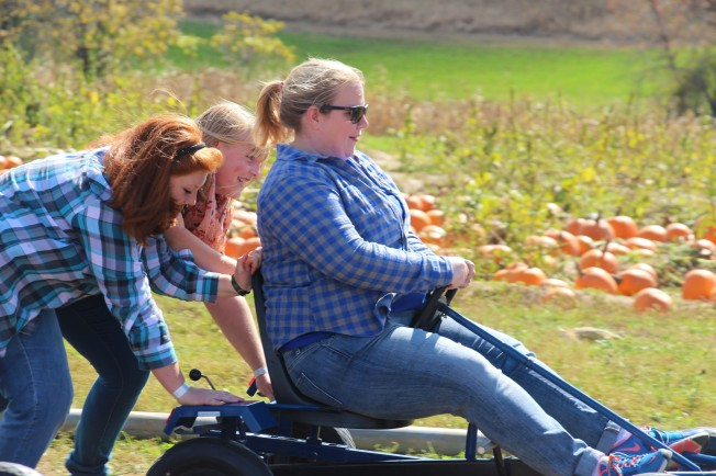 Olivia and Grace giving their science teacher a push. Could this count as a physics lesson? :)