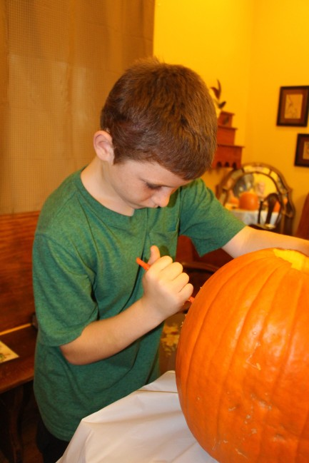 This year Tyler not only drew his design on the pumpkin but also carved it himself. (He used a safety knife)