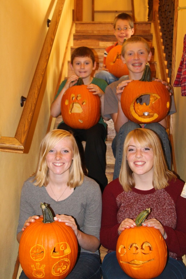 My five little pumpkins holding their completed Jack O' Lanterns.