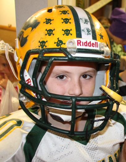 Tyler liked having an excuse to wear his football uniform. :)
