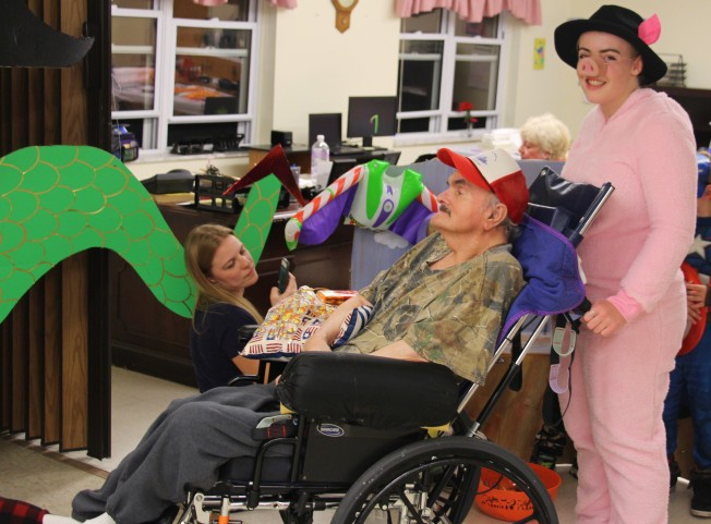 Gracie pushing one of the residents around to trick or treat.