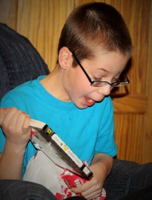 Ozzie was THRILLED with his new Diary of a Wimpy Kid book from Rusty.